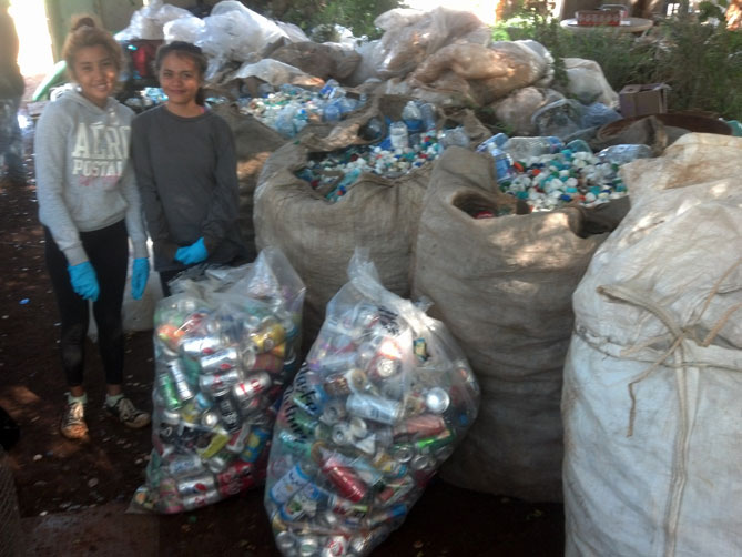 Worker girls with their sorted recyclables